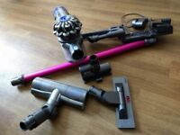 2 Dyson vacuums one cylinder one cordless