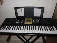 Black Yamaha YPT220 portable keyboard and stand