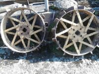 A pair of steel tractor wheels for a Gunsmith or BMB Ploughmate.