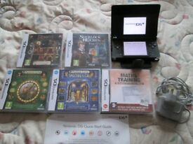 Nintendo DSi Black Handheld System bundle,5 games which are professor layton and the spectres call,.