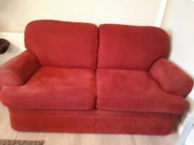 2 x 2 seater red sofa's, they are in good condition and have been in a house with non smokers.