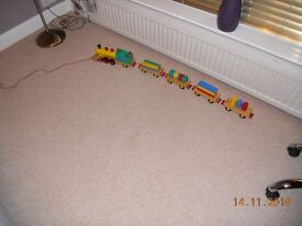 WOODEN TRAIN SET with engine, carriages and bricks in various shapes to fit in carriages. £20