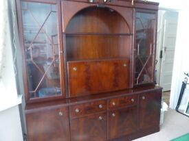 Wood and glass tall unit.