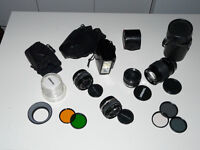 Olympus OM set (28mm + 50mm + 135mm + tele converter + flash unit + filters + bag)
