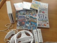 Nintendo Wii with gaming handsets and games