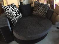 Round storage cuddler sofa
