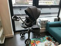 Stokke Xplory V4 with compatible car seat, shopping bag, moustiquaire & rain canopy