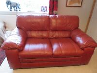 Leather sofa , Excellent condition unmarked, red, 2 seat, high quality. Heavy. REDUCED PRICE
