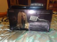 Babyliss heated smoothing brush in box with instructions.