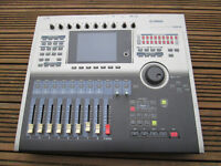 Yamaha AW2816 x 2, can be sync'd together to make a 32 track hard disk recording studio