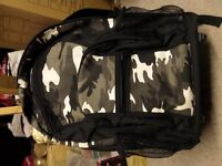 Camoflage backpack complete with hidden wheels