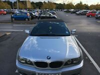 BMW 318 CI Convertible M Sport and Hyundai Accent