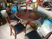 Table and 4 piece chair set with glass top