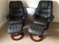 Pair of brown leather swivel recliner chairs with foot stools. In excellent condition, not used much