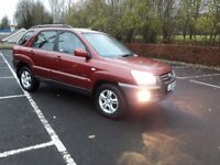2005 red kia sportage