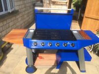 Outback Monarch 6 burner gas barbecue, two barbecue grids, one reversible griddle. Great condition