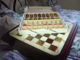 Cream and brown chess set with table
