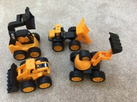 Four JCB Toy Trucks and Dinosaur and Rocket