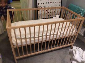 Ikea wooden cot, mattress & protector. Sniglar cot