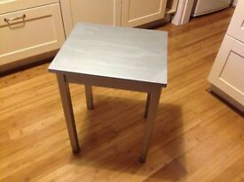 Table small wooden, silver metallic paint, 57 cm tall varnish protected, beautiful clean condition.