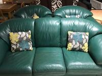 Three piece green leather suite