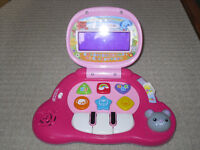 Pink V-tech baby lap top