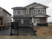 Brand New 3 bedroom in Pilot Butte with attached garage!