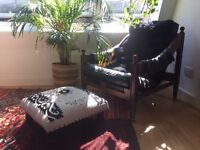 Comfy vintage black tufted chair, foot stool and sheepskin optional