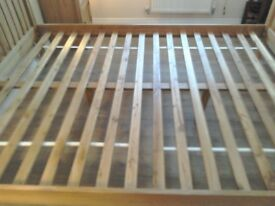 King size 5ft solid oak bed for sale. Nearly new.