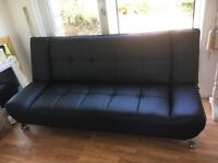 Black Faux Leather sofa bed in very good condition