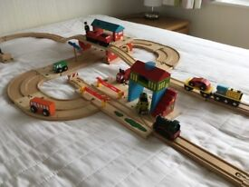Huge wooden road and rail set, with masses of train track and trains, with interconnecting road set