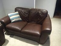 2 leather sofas & foot stool