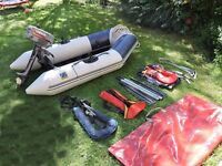 Small Zodiac dinghy and with outboard and life jackets