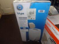 blyss air conditioner/dehumidifier brand new in box