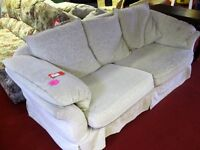 Sofa bed - metal framed in cream coloured patterned fabric [8491]