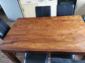 Solid wood table and 5 black leather chairs