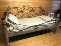Handcrafted wood and iron bed
