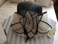 Lovely black and white unworn hat new with tags