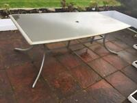8 seater indoor/outdoor glass table, 8 chairs, 8 cushions
