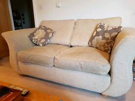 2 DFS two-seater Sofas in cream with foot stool