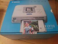 Canon SELPHY CP720 Portable Photo Printer (white). Excellent condition never used.
