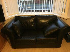 2 black leather sofas , bargain £400