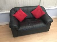 Black leather modern design sofa - ideal if space is limited