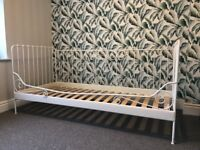 White metal day bed with wooden slats