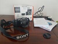 Sony Alpha 5000 digital camera for sale.
