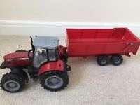 Massey ferguson red tractor and trailer, good condition and lots of fun for children