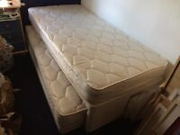 Single divan bed with pull out guest bed
