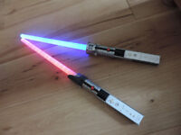 Two Wii light saber units by Trustmaster
