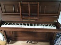 Piano, manufactured by bishop and sons reasonable condition, requires tuning