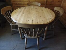 Solid pine extended carved dining table with 4 spindle back pine dining chairs
